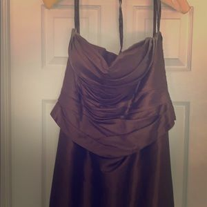 Two piece strapless Bronze gown.
